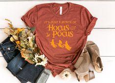 Hocus Pocus Shirt, Sanderson Sister Shirt, Salem Shirt,  It's Just a Bunch of Hocus Pocus Shirt, Halloween Shirt, Disney Halloween, Witch  #halloweenshirt #salemwitch #salemshirt #hocuspocus #sandersonsisters #trickortreat #fallshirts #halloweendecorations Disney Halloween, Halloween Shirt, Halloween Costumes, College Must Haves, Hocus Pocus Shirt, Sanderson Sisters, Sister Shirts, Fall Shirts, Witch