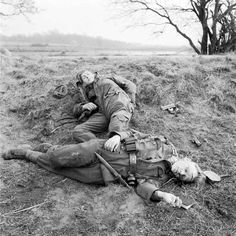 Two young German soldiers, one injured, the other dead. As they advanced into Germany, the Allied soldiers were constantly surprised at the extreme youth of the enemy forces. MAR 27 1945 British infantry attack against dug in Fallschirmjäger. German Soldiers Ww2, German Army, Man Of War, Ww2 Photos, Germany Ww2, World War One, Luftwaffe, Military History, World History
