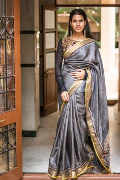 A rich tussar drape with Kalamkari worked pallu and discreet and classy detailing for the border. Classy and simple. A no brainer pairing of a black blouse. Or do a gold tissue blouse and sparkle away! #kalamkari #tussar #grey #saree #India #blouse #houseofblouse