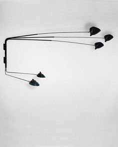 Modern sconces from iconic French designer Serge Mouille.