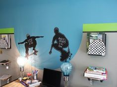 A teenaged boy will need a desk for homework and the skateboard shelves are a great way to keep things organized. The chalkboard skateboarders on the wall are a fun touch.