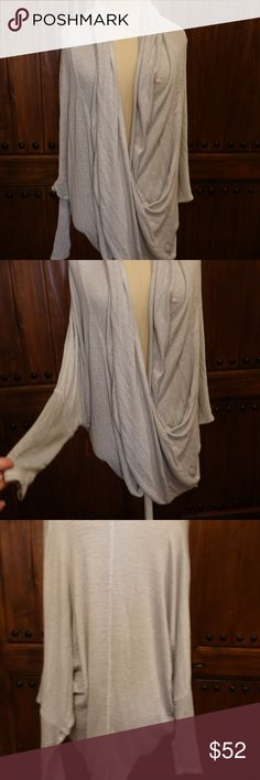 Free People wrap top Size XS Gorgeous wrap top from Free People!  Never worn and in great condition. Light Grey in color Free People Sweaters Shrugs & Ponchos