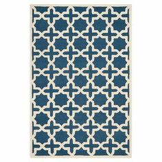 Hand-tufted wool rug with a geometric trellis motif.    Product: RugConstruction Material: WoolColor: Navy blue and ivoryFeatures: Hand-tufted Note: Please be aware that actual colors may vary from those shown on your screen. Accent rugs may also not show the entire pattern that the corresponding area rugs have.Cleaning and Care: Professional cleaning recommended