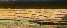 Side of barn in Arkansas made from slabs of timber