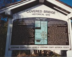 1990, the sign for the covered bridge that i took a pic of and crossed on a horse & buggy.  clip, clop.  Sunny Valley, OR