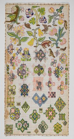 Spot sampler, mid-17th century English Linen canvas worked with silk and metal thread; stitches include tent, cross, back, plaited braid, detached buttonhole, knots, and laidwork 21 3/4 x 10 5/8 in. (55.2 x 27 cm)