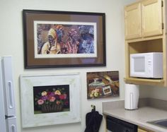 My studio apartment kitchen - in small spaces, think 'outside the box,' here I have some of my favorite art pieces in my tiny kitchen.  Function does not have to be blah. http://somethingbeautifuljournal.blogspot.com/2008/06/my-apartment-temporary-but-pretty.html