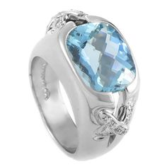 """Tiffany & Co. Jean Schlumberger Aquamarine Diamond Platinum Ring. The splendid design of this ring created by Jean Schlumberger and Tiffany & Co. transcends time with its cool beauty. The ring is made of platinum and is set with a faceted aquamarine stone. Lastly, two of Schlumberger's signature """"X"""" motifs are featured on the shanks and are set with diamonds."""