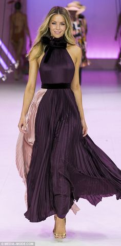 Swish: Jen twirled on the catwalk in a purple and pink pleated maxi dress with a pussybow neckline