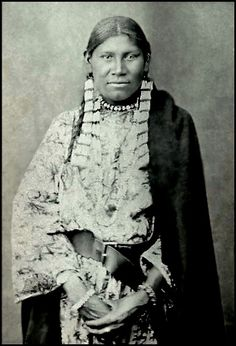 An unidentified woman of the Assiniboine Nation. No date or additional information.