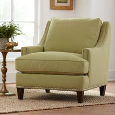 Larson Nailhead Trim Chair | With details like graceful tapered legs, curved track arms, and stately nailhead trim, this chair boasts classic beauty. A welted box cushion and tightly tailored upholstery accent a polished silhouette.