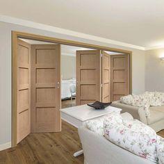 Thrufold Shaker Oak 4 Panel Solid 3+2 Folding Door  - Lifestyle Image.    #shakerfoldingdoors #shakerbifolds