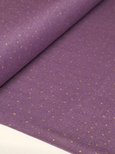 100% Cotton fabric designed by Studio 8 for Quilting Treasures. This stylish print is accented with metallic gold dots on a lilac background. It is sure to create a striking project for home decor, apparel, quilts, and more!  **Fabric is uncut so multiple purchases will be shipped