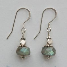 "Labradorite gemstone earrings. Iridescent labradorite faceted roundels and India sterling silver beads on sterling silver french hook ear wires. 1 1/2"" long."