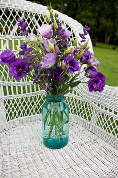 The perfect center piece - My favorite flowers, purple Lisianthus in a blue mason jar!