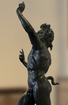 Dancing faun (close-up). Bronze. 2nd century B.C. Height 71 cm. Inv. No. 5002. Naples, National Archaeological Museum.