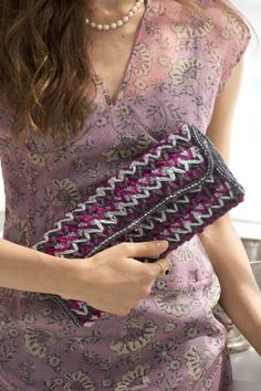 This crochet clutch using a spike stitch pattern is great for any evening wedding reception.