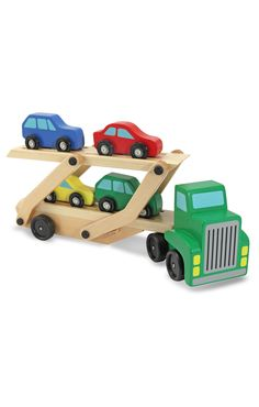 Kids build motor skills and use their imaginations as they push around wooden truck with four wooden cars that can be loaded and unloaded