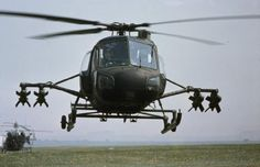 """rideoutprotectorsoftherealm: """" A Westland Scout of the Army Air Corps hovers just above the ground for the camera during a NATO training exercise, May The helicopter is armed with four wire. The Heart Of Man, Military History, Army, Wasp, Cold War, Helicopters, Bobs, Vehicles, Universe"""