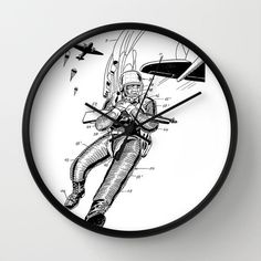 """Clock, Clock parachute man, parachute man Patent Clock, Modern Clock, The parachute man Clock, Spacesuit  clock, parachute man clock by STANLEYprintHOUSE  47.00 USD  Available in natural wood, black or white frames, our 10"""" diameter unique Wall Clocks feature a high-impact plexiglass crystal face and a backside hook for easy hanging. Choose black or white hands to match your wall clock frame and art design choice. Clock sits 1.75"""" deep and requi ..  https://www.etsy.com/ca/listing/.."""