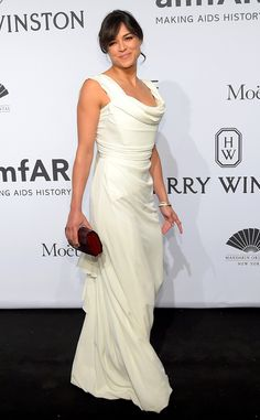 Michelle Rodriguez from Stars at the 2015 amfAR New York Gala  In Vivienne Westwood.