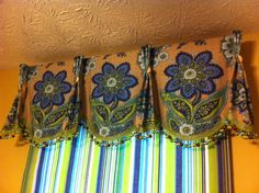 Eye-catching valance. Would have done the shade in some other fabric