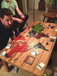 Risk Board Game Carved into a Coffee Table- how great would this be to woodburn on an ikea table?!