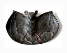 c1898 Cast Iron Bat Antique Ashtray