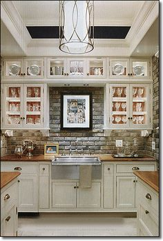 I like the faux brick backsplash!