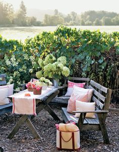 outdoor table with benches overlooking farm fields