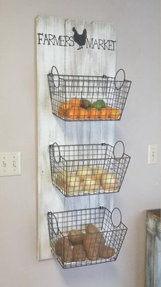 Farmers Market Basket Produce Storage  This quaint farmers market basket storage would be a wonderful addition to any fixer upper or farmhouse style kitchen. It is also a convenient way to store fruits and vegetables. This piece is a wood slat design with an aged look. Its overall