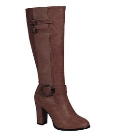 Walk tall and totally stylish with these beautiful boots. A tall heel brings this pair to eye-catching heights, while the sleek design and decorative buckles boost the appeal of any outfit.3.5'' heel13'' shaft15'' circumferenceZipper closureMan-madeImported