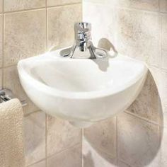 small corner sink  American Standard's Minette lav is 11x16 3/4 inches