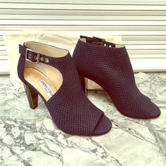 """Jimmy Choo navy booties- never been worn These amazing booties have never been worn. They are navy with """"scale-like"""" stitching detail. They have a buckle closure at the ankle and a killer shiny black heal. Jimmy Choo Shoes Ankle Boots & Booties"""