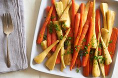 In this simple side dish, carrots and parsnips are simmered in a few pats of butter and a splash of water until tender, then hit with a dash of lemon juice and a sprinkling of fresh herbs. Use the smallest carrots and parsnips you can find; the smaller, the sweeter. (Photo: Melina Hammer for The New York Times)