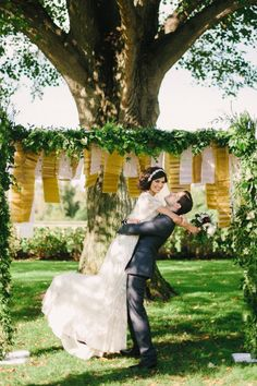 Add pleated tissue paper to a garland arch to get this backdrop.