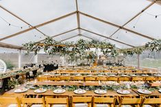 marquee structure, clear roof marquee, festoon lighting, vintage tables, wooden padded folding chairs, south coast weddings, marquee weddings, south coast party hire
