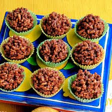 Chocolate Crackles made with Shortening, icing sugar, Cocoa, rice bubbles and coconut. These are also known as Chocolate bubble cakes.