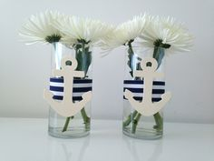 This nautically inspired vase is the perfect addition to your nautical themed party! The vase is approximately 7.5 in height and 3.5 in diameter. The quantity included in this listing is for 12 vases. If you are in need of more vases, or if you would like to change the color of the ribbon please send a message and I will be more than happy to make a Custom Order for you