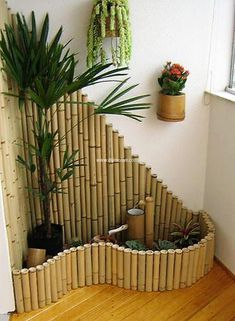 If you are willing to decorate your small balcony, porch or doorway then try this awesome bamboo planter setting. It is a small garden in itself. The hanging big bamboos are used as planters on wall. However, other small and bigger plants are planted in the bamboo boundary.