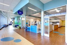 Open and transparent multispecialty clinic entrances allow natural light to permeate the area while helping the staff to maintain visual contact with the family waiting areas. As with the specialty clinics, these multispecialty entrances are each given an accent color for intuitive wayfinding. Photo: William Manning Photography/William Manning.