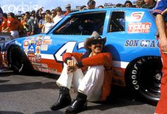 Richard Petty, driver of the no. 43 STP Pontiac, takes time out before getting into his car for the start of the 1983 Daytona 500 Image George Tiedemann  Corbis