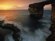 Get Wallpaper  Gozo Island, Malta Photograph by Michael Melford  Twilight falls on Gozo island off the Maltese coast. Malta enjoys a pleasant Mediterranean climate characterized by damp and cool winters and warm, dry summers.