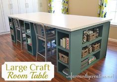 """Large Craft Table-  I tweaked Ana White's Modern craft table plan to make three oversized bases with a laminate countertop. On Ana's plan there was 3 sets of cubbies on one side.  I tweaked her plan to include the same set of cubbies on the other side so it was symmetrical.  That allowed each of my bases to measure 50 1/2"""" wide instead of 38"""""""