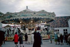 New York World's Fair 1964-65 Belgium Village Carousel...If you have never seen galloping horses and rocking carousel gondolas you have to see the video on this page! Music is by paper rolls and shown as well!