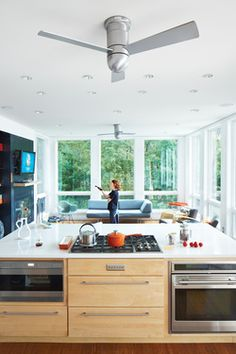 A Lakeside Prefab in New Jersey | Dwell   Recessed Cans, 5 burner cooktop, ovens.