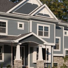 This home has a design and color combo:  Hardieplank siding on the lower sections in Boothbay Blue, with Hardieshake in Evening Blue on the gables.  We install Hardie fiber cement siding in the Minneapolis St. Paul MN area. http://www.quarve.com