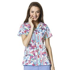 Polka-dots and flowers make for a unique and pretty stretch print. This V-neck scrub top from WonderFLEX by WonderWink is made in a premium fabric for comfort and style. #nurse #doctor #hospitalstyle #medicalstyle #scrubs #flowers