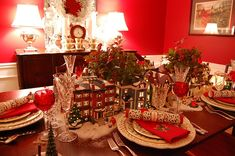 Lighted houses from the Dept. 56 Snow Village Collection ,Lenox Holiday china, Towle King Richard flatware & Waterford stemware.
