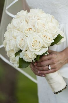 A classic wedding bouquet of all white roses. Roses come in a wide variety of colours; we can customize this bouquet to fit in with your wedding's colour scheme. Bouquet Bride, Rose Wedding Bouquet, White Wedding Bouquets, Bridal Flowers, Bridesmaid Bouquets, Wedding Bridesmaids, White Rose Bouquet, White Roses Wedding, Floral Wedding